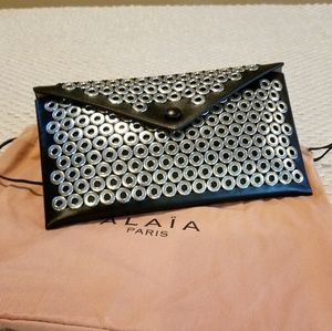 AUTHENTIC Alaia studded envelope clutch NWT